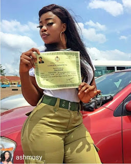 Corper Flaunts Both Her Certificate And Curves In This Photo