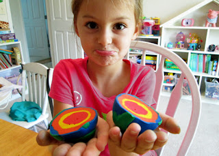 Tessa wasn't very happy about cutting open her model. After explaining that was the whole point of making it, she correctly identified the layers...inner core (red), outer core (yellow), mantle (orange) and the Earth's crust (blue and green).