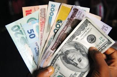 Naira and Dollar bills