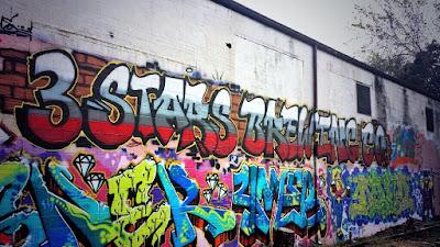 Graffiti mural at 3 Stars, facing the train/Metro tracks.