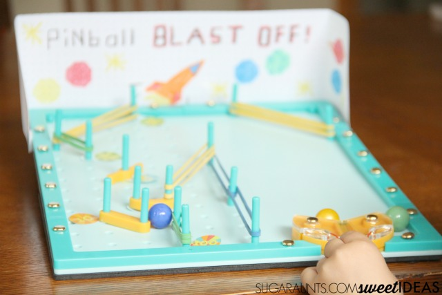 Build fine motor skills with a DIY pinball machine activity from Kiwi Crate. Kiwi Crate review for hands-on creativity, learning, and development.