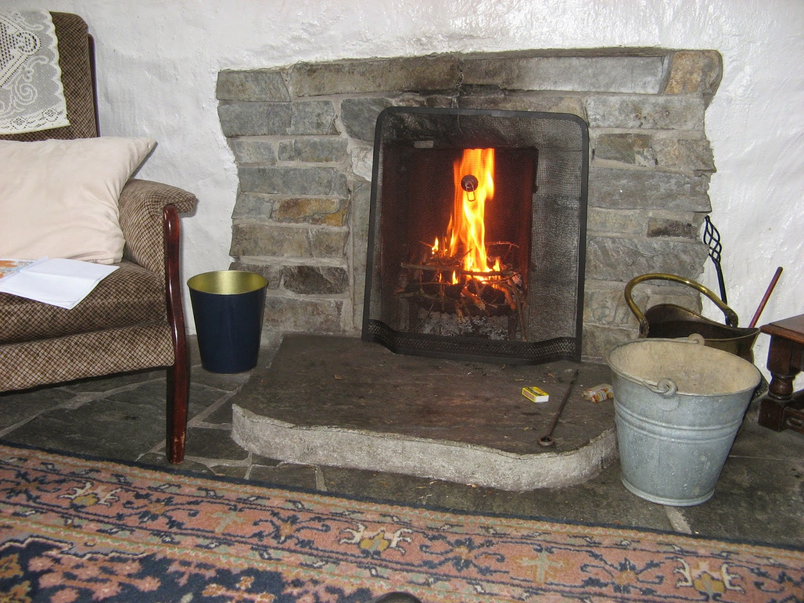 stone fireplace and a coal fire