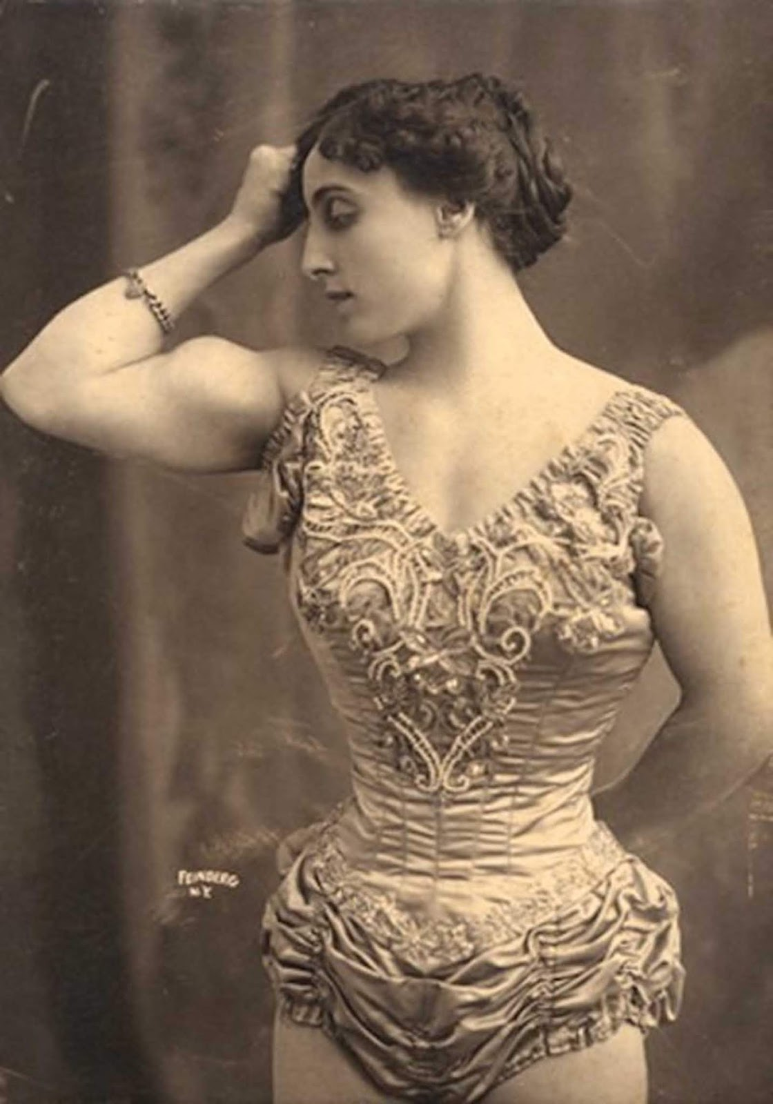 'Iron Woman' circus performer, 1905.