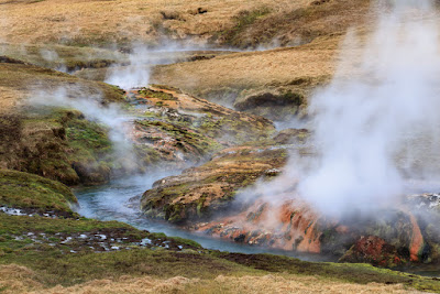 steam coming out of Reykjadalur hot springs