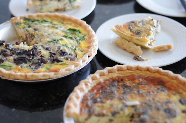 two baked quiches with a perfect pie slice