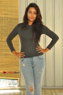 Bhanu Tripathi Pictures in Ripped Jeans at Iddari Madhya 18 Movie Pressmeet