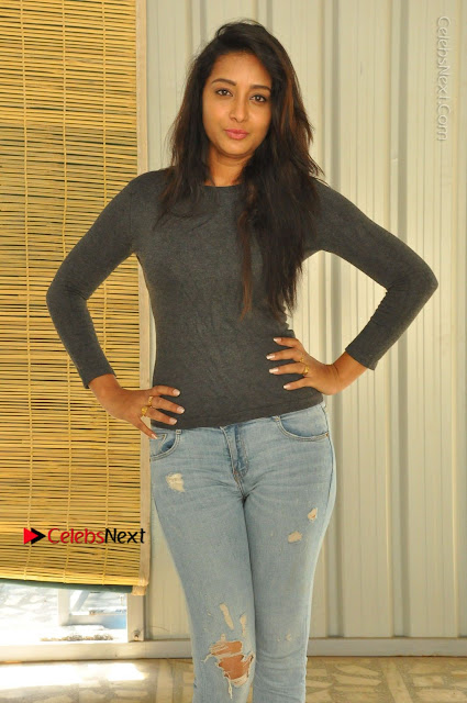 Actress Bhanu Tripathri Pos in Ripped Jeans at Iddari Madhya 18 Movie Pressmeet  0001.JPG