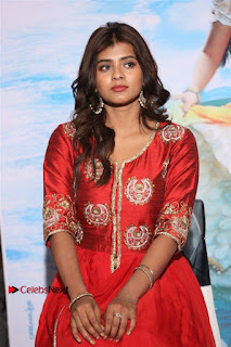 Actress Heba Patel Latest Stills in Red Dress at Mister Movie Trailer Launch Event  0016.jpg