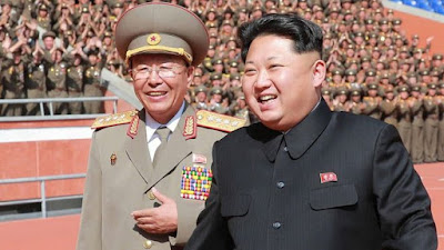 Kim Jong-un (R) with Ri Yong-gil at a military parade in October 2015