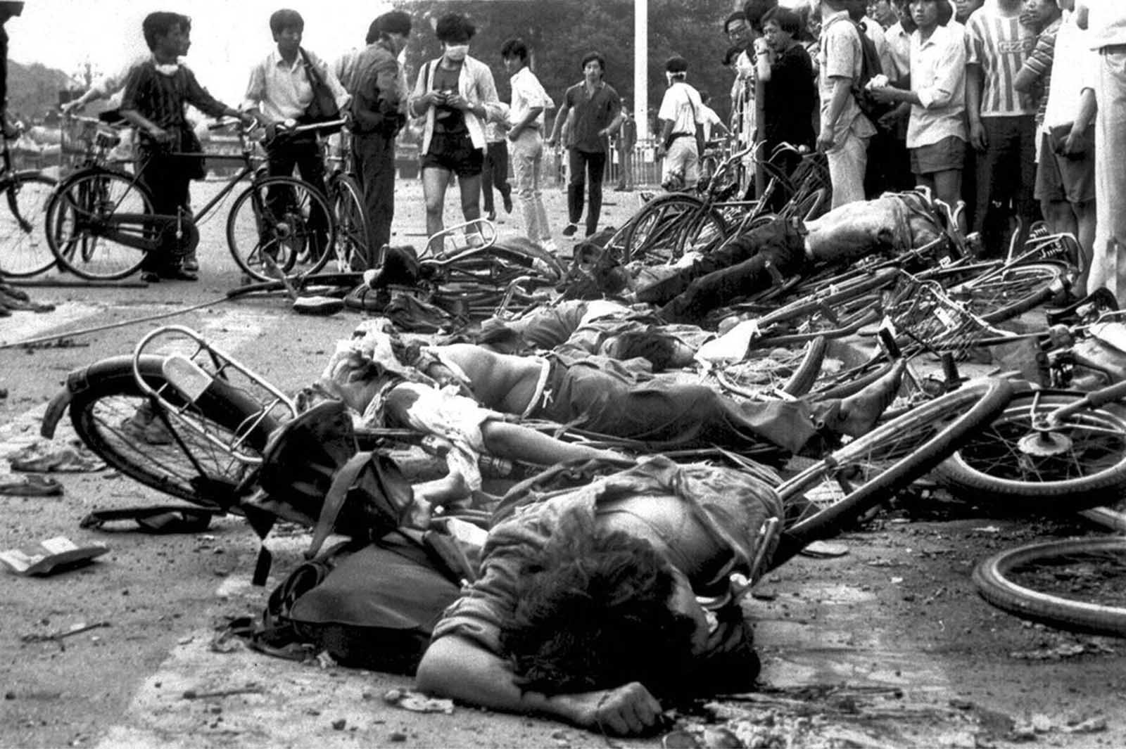Bodies of dead civilians lie among crushed bicycles near Beijing's Tiananmen Square, on June 4, 1989.