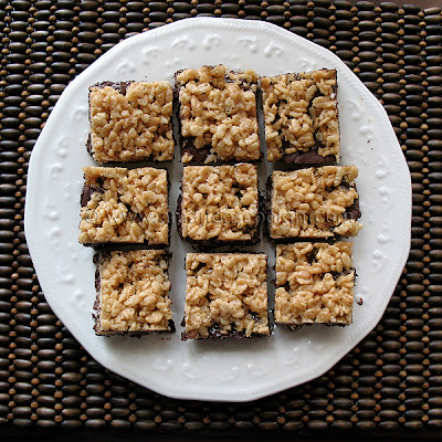 An overhead photo of chewy cookie crunch bars on a white plate.