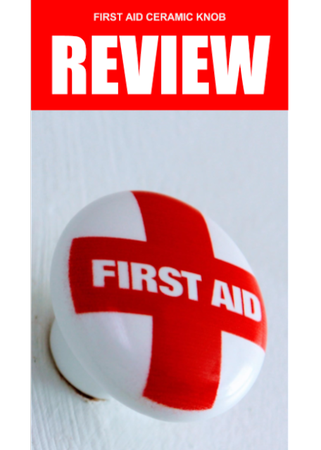 "First Aid Ceramic Knob on Zazzle - The knob attached to a cupboard with the letters ""First Aid"" in front of a red cross."