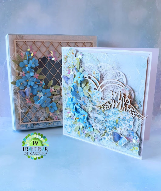 Wedding card in a box with forget me not flowers