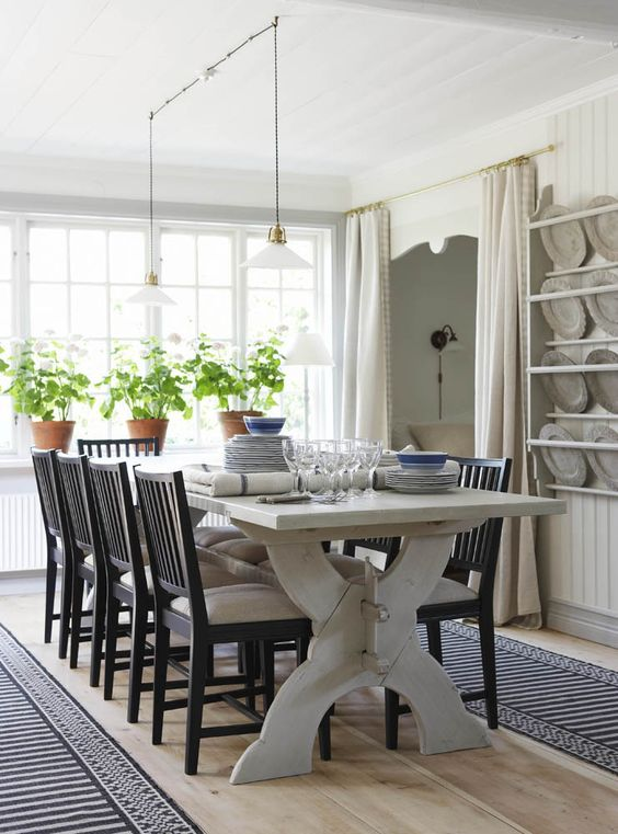Scandinavian style dining room with Swedish chairs - found on Hello Lovely Studio
