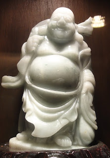 shop with white jade buddha sculpture