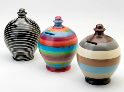 three money pots in striped patterns