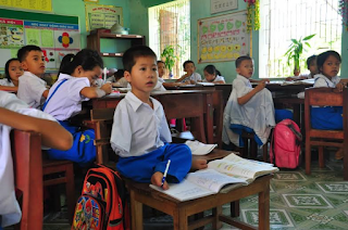 Ten year old boy born without arms can do school work with his feet
