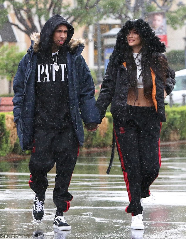 Drunk-in-love Tyga and Kylie Jenner rock matching outfits and hold hands as it snows (photos)