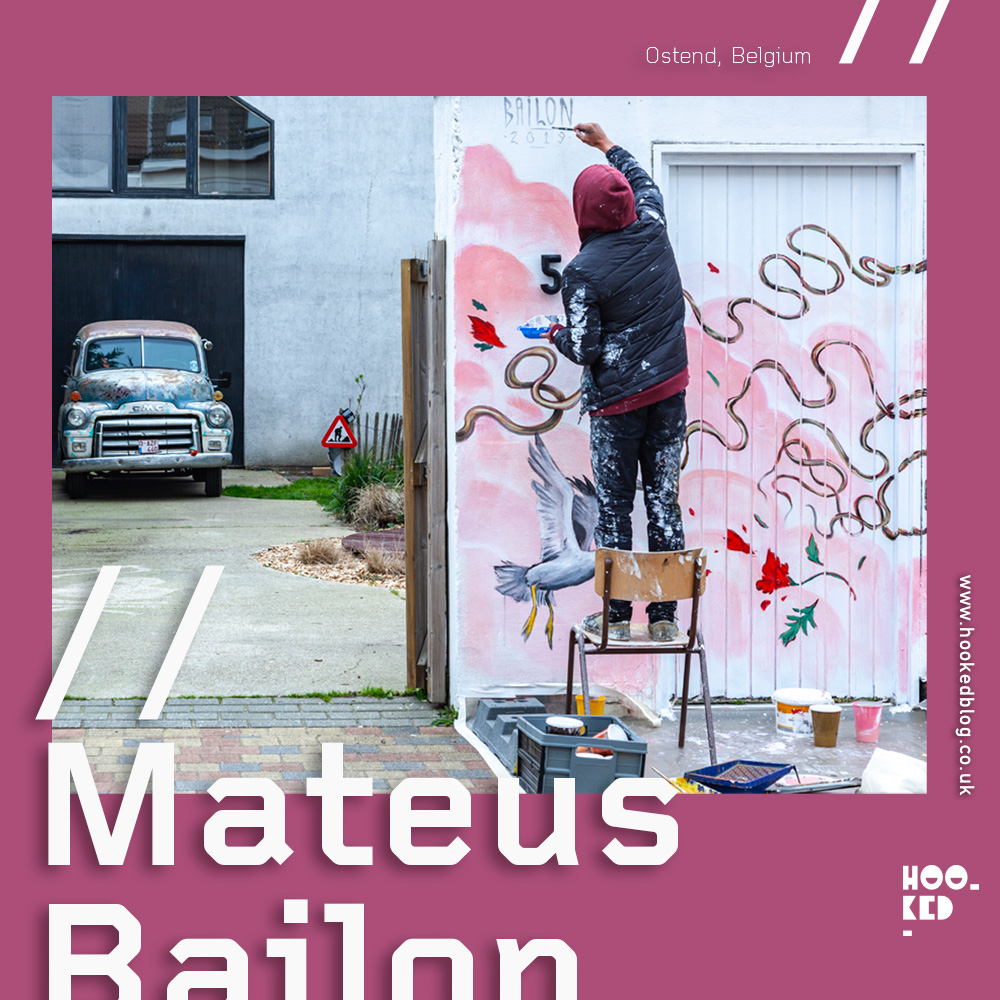 Artist Mateus Bailon on a chair painting a New Mural in Ostend