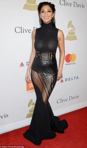 Nicole Scherzinger goes braless in sheer dress at Pre-Grammy occasion