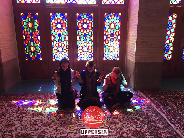 Travalers visiting Nasir ol Molk Mosque of Shiraz.