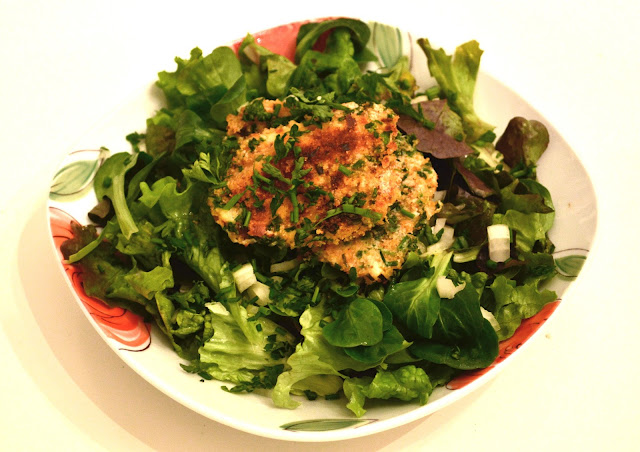 Herbal-Breaded European Perch on top of a green spring salad