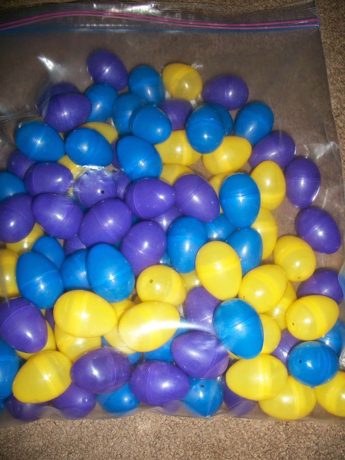 yellow, blue and purple plastic easter eggs