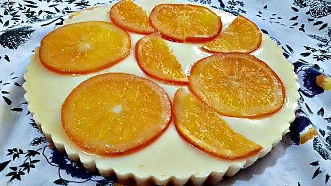 Tarta de leche condensada con naranja confitada