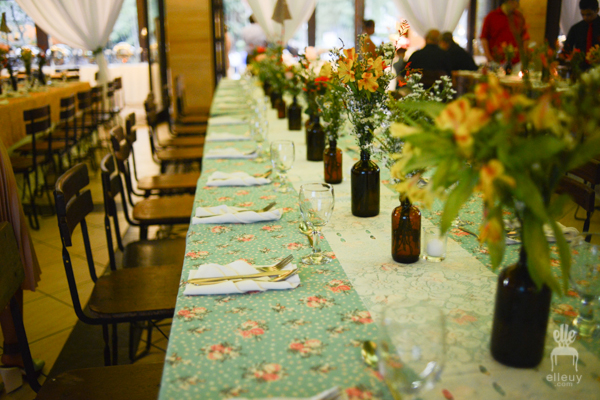 vintage wedding table set-up, amber bottles centerpiece