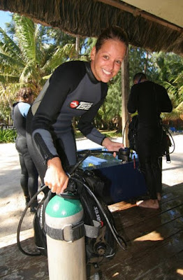 photo of Ellis with a dive tank after a dive on Dominican Republic