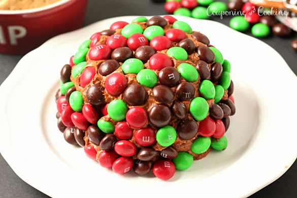 A gingerbread twist on a traditional dessert cheeseball, topped with Gingerbread M&M's it's the perfect holiday dessert! www.CouponingNCooking.com