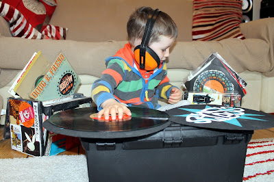 my son pretending to be a DJ