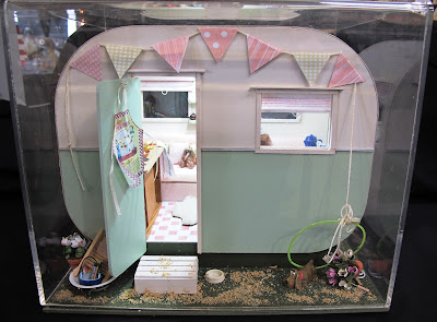 One-twelfth scale miniature vintage caravan