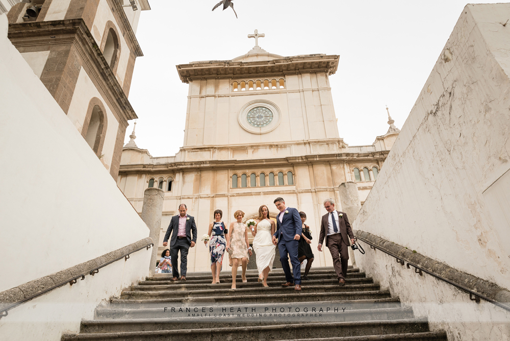 Wedding party walking by Positano church