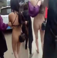 (Photos) Husband's Mistress Paraded on the Streets Naked by Wife