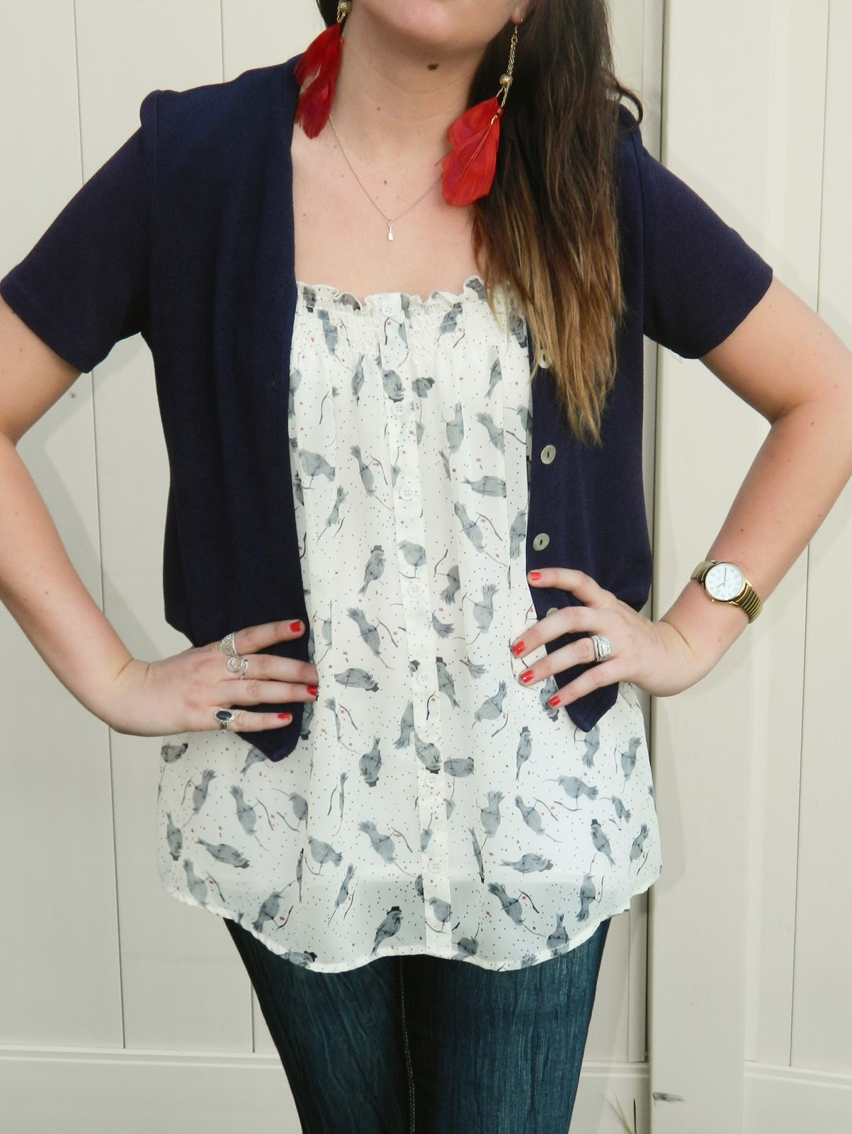 feather earings, floral top, blue cardigan