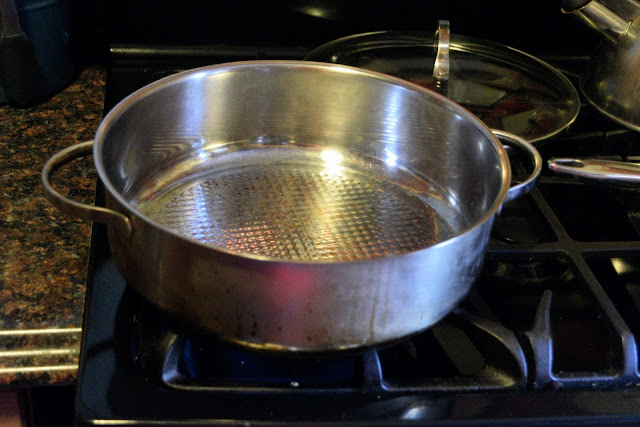 A deep skillet on the stove.