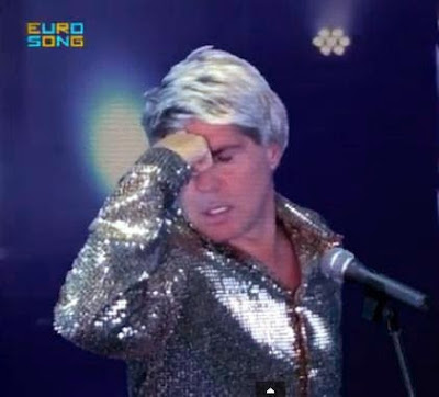 Tam Harrow, la parodia del cantante anni '80 impersonata da Tom Hooker