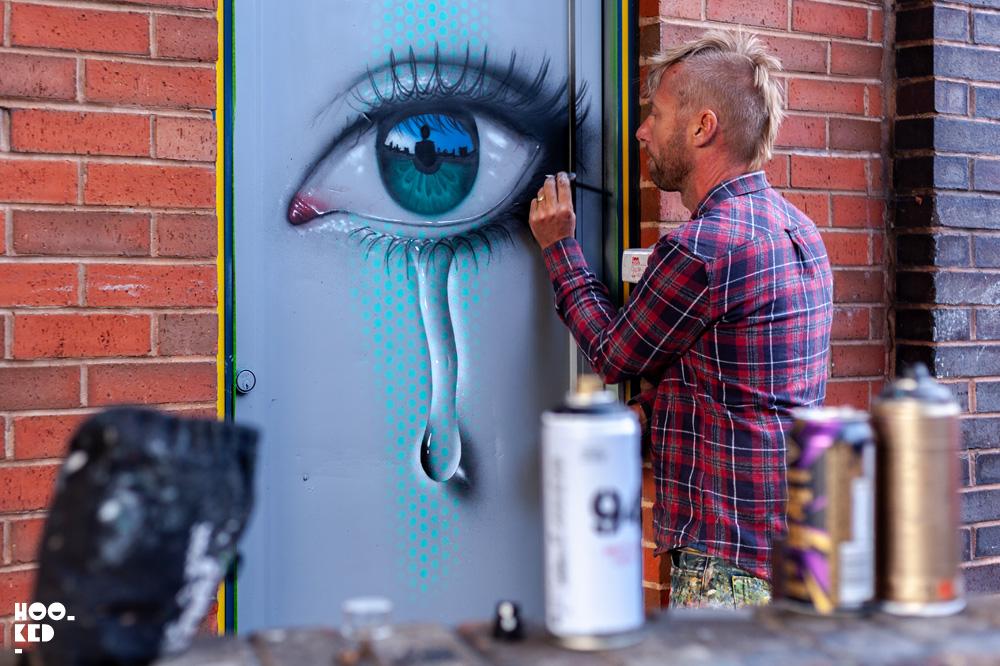 Street Artist My Dog SIghs at work in Cheltenham, UK for the Cheltenham Paint Festival