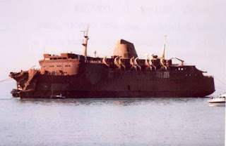 The charred wreck of the Moby Prince pictured  in the days after the tragedy that claimed 140 lives