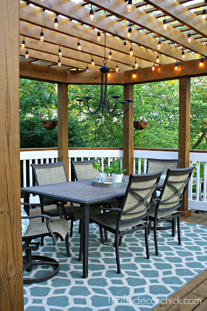 Wood pergola on deck with lights