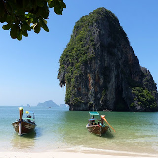 Boats by a secluded beach in Krabi