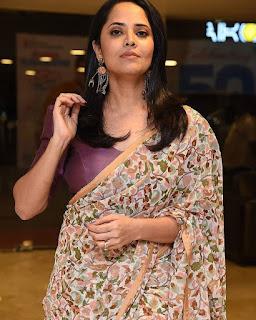 Anasuya bharadwaj in purple blouse and floral design silk saree Navel Queens