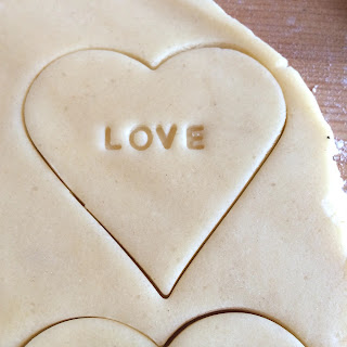 Heart shaped biscuit dough with love stamp