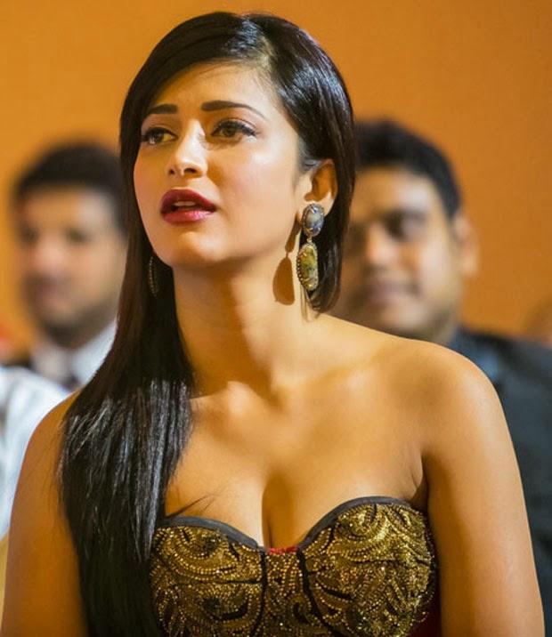 Shruti Haasan Long Hair Sizzling Stills In Maroon Gown