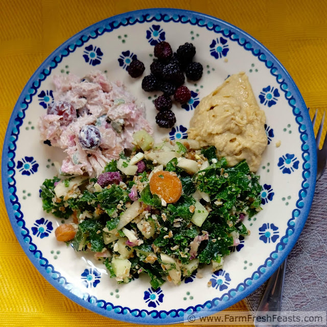 a square image showing a plate of CSA farm share chopped salad with side dishes
