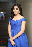 Actress Ritu Varma Pos in Blue Short Dress at Keshava Telugu Movie Audio Launch .COM 0051.jpg