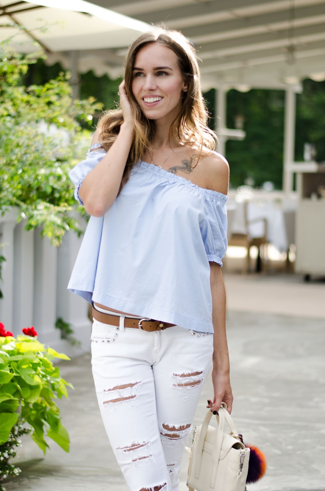 light blue off shoulder top white ripped jeans outfit