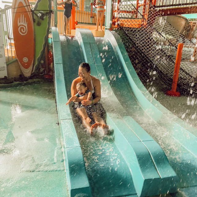 mom and son sliding down water slide at the fallsview waterpark