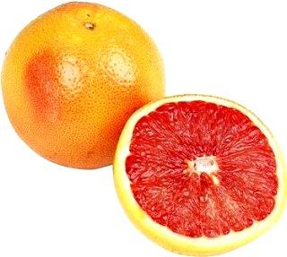 Foto de la toronja entera y a la mitad - Fruta cítrica